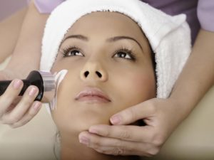 Woman having microdermabrasion